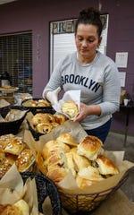 Jennifer Betances of Fresh Baked wraps up a fresh handmade croissant during the Oconomowoc Winter Farmers Market on Nov. 4.