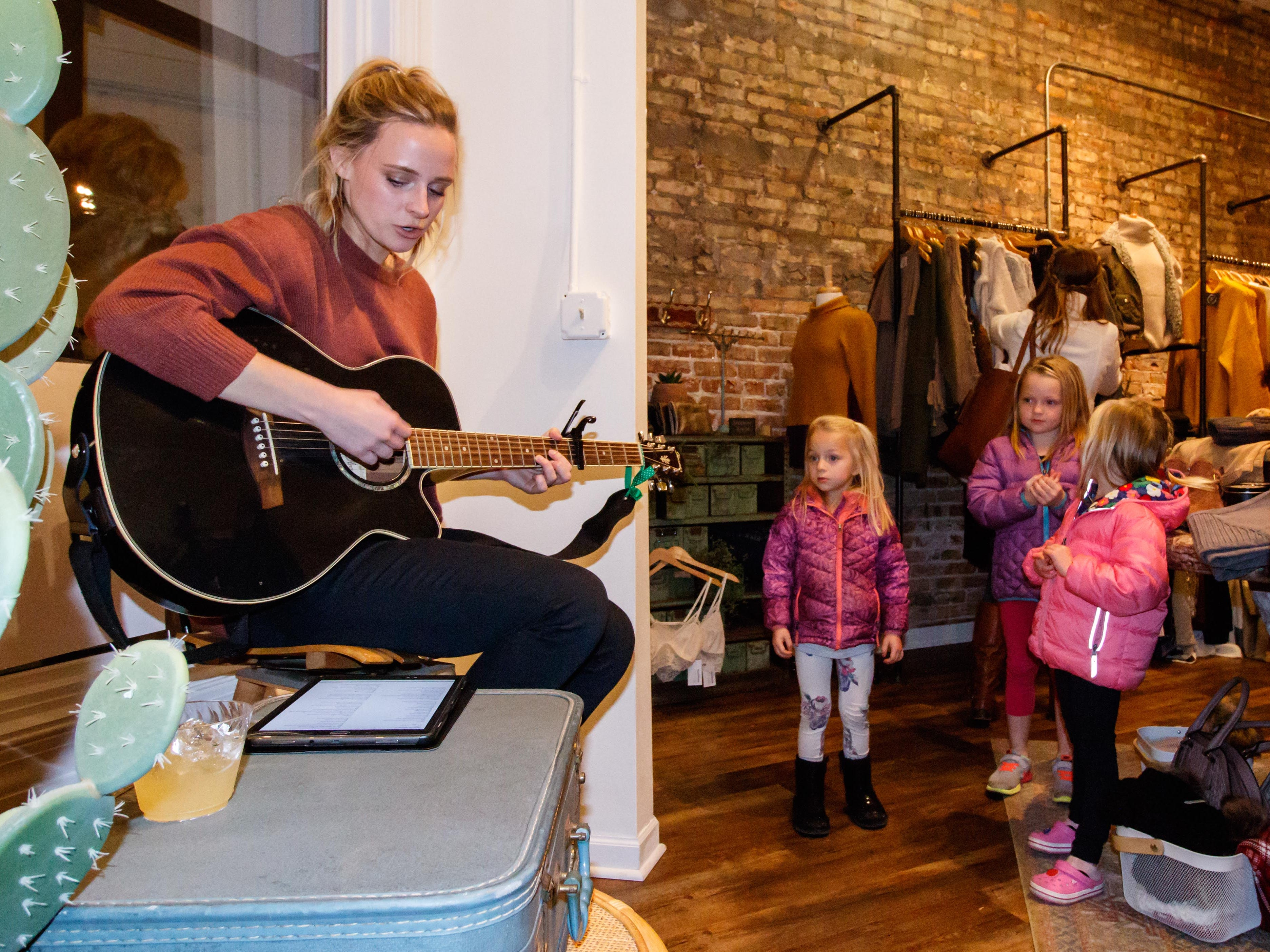 Singer songwriter Bethany Unkefer of Milwaukee entertains shoppers at Fray Boutique in Oconomowoc during the annual Fall Gallery Night event on Friday, Nov. 2, 2018.