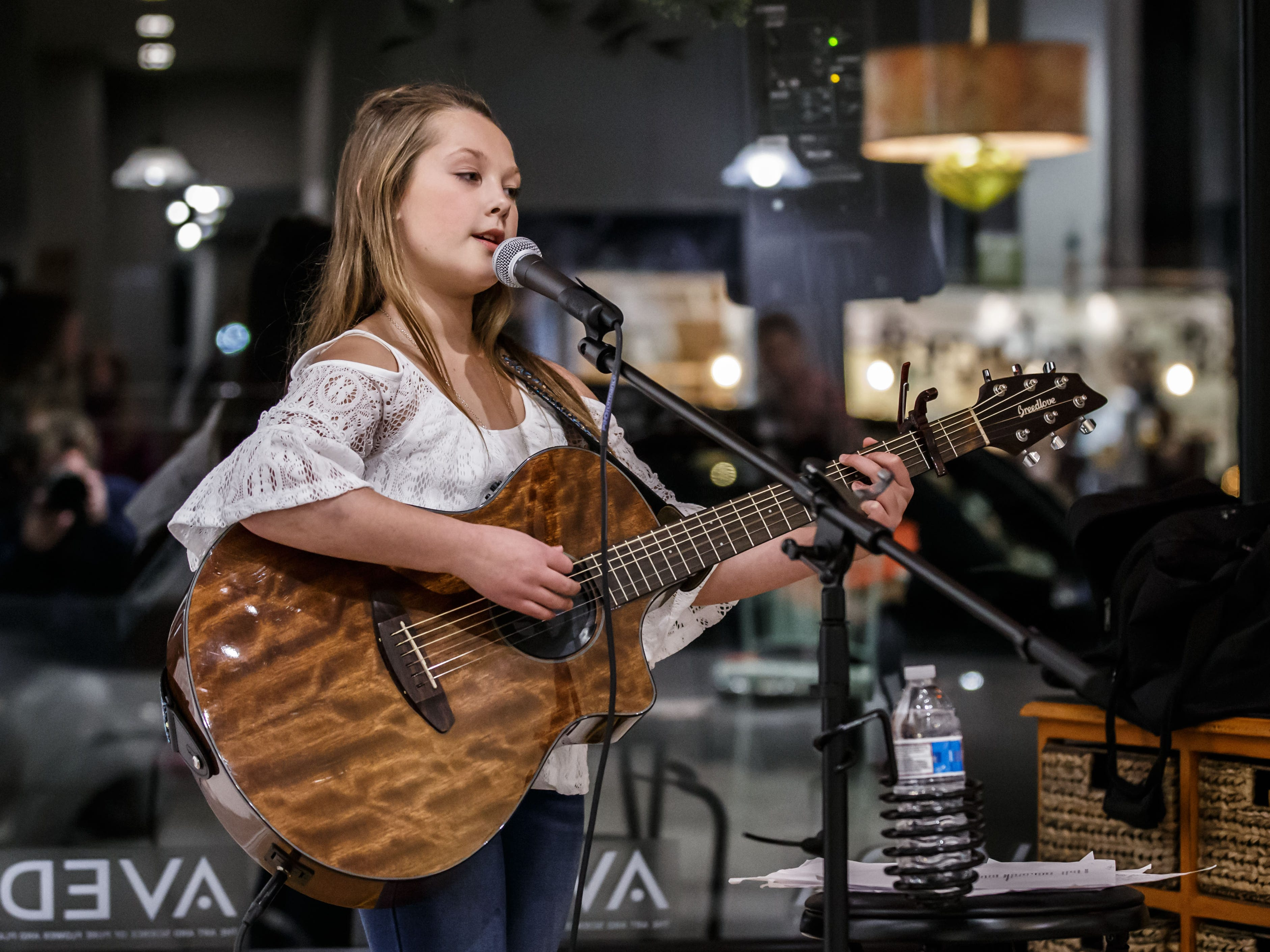 Singer songwriter Sadie Jo Schwefel, 11, of Oconomowoc performs at Ambiance Salon during the annual Fall Gallery Night in Oconomowoc on Friday, Nov. 2, 2018.