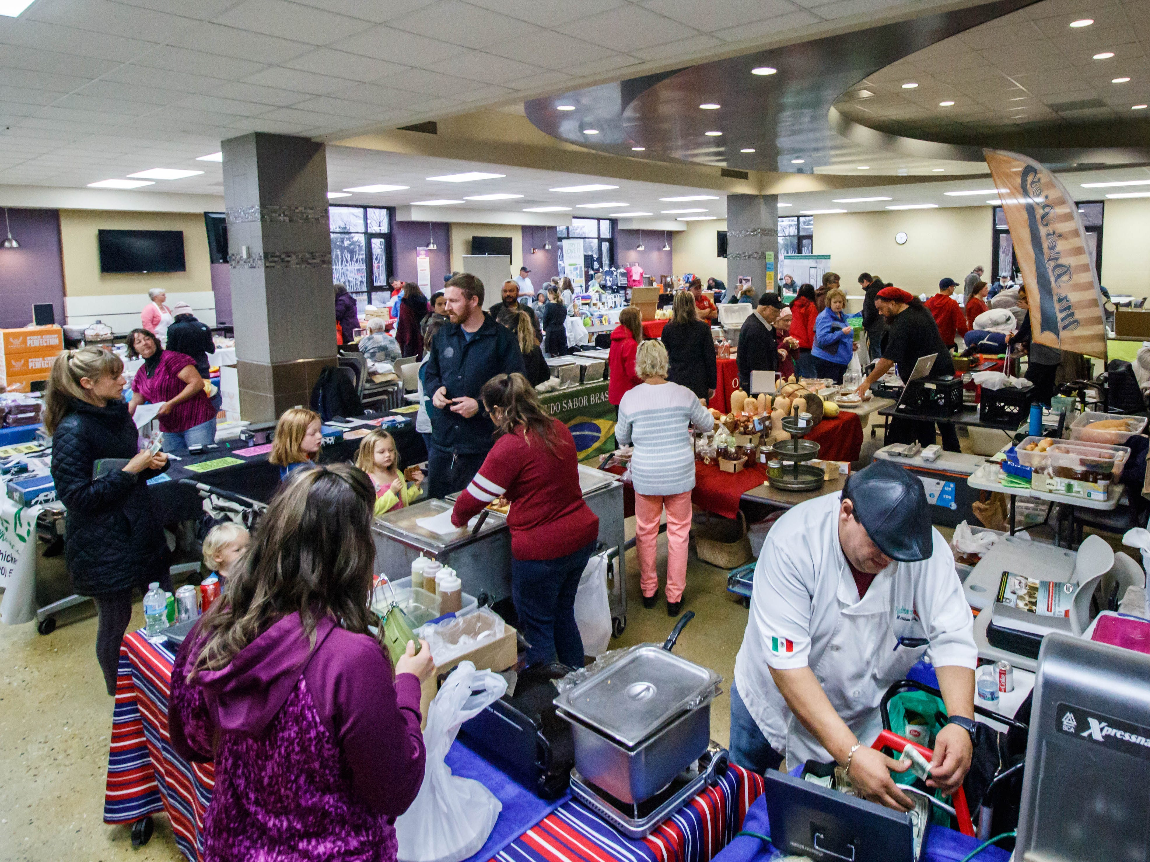 Customers shop for farm fresh products and handmade crafts during the Oconomowoc Winter Farmers Market at the high school on Sunday, Nov. 4, 2018. The winter market is open from 9:30 a.m. to 1:00 p.m. every Sunday through March 31st.