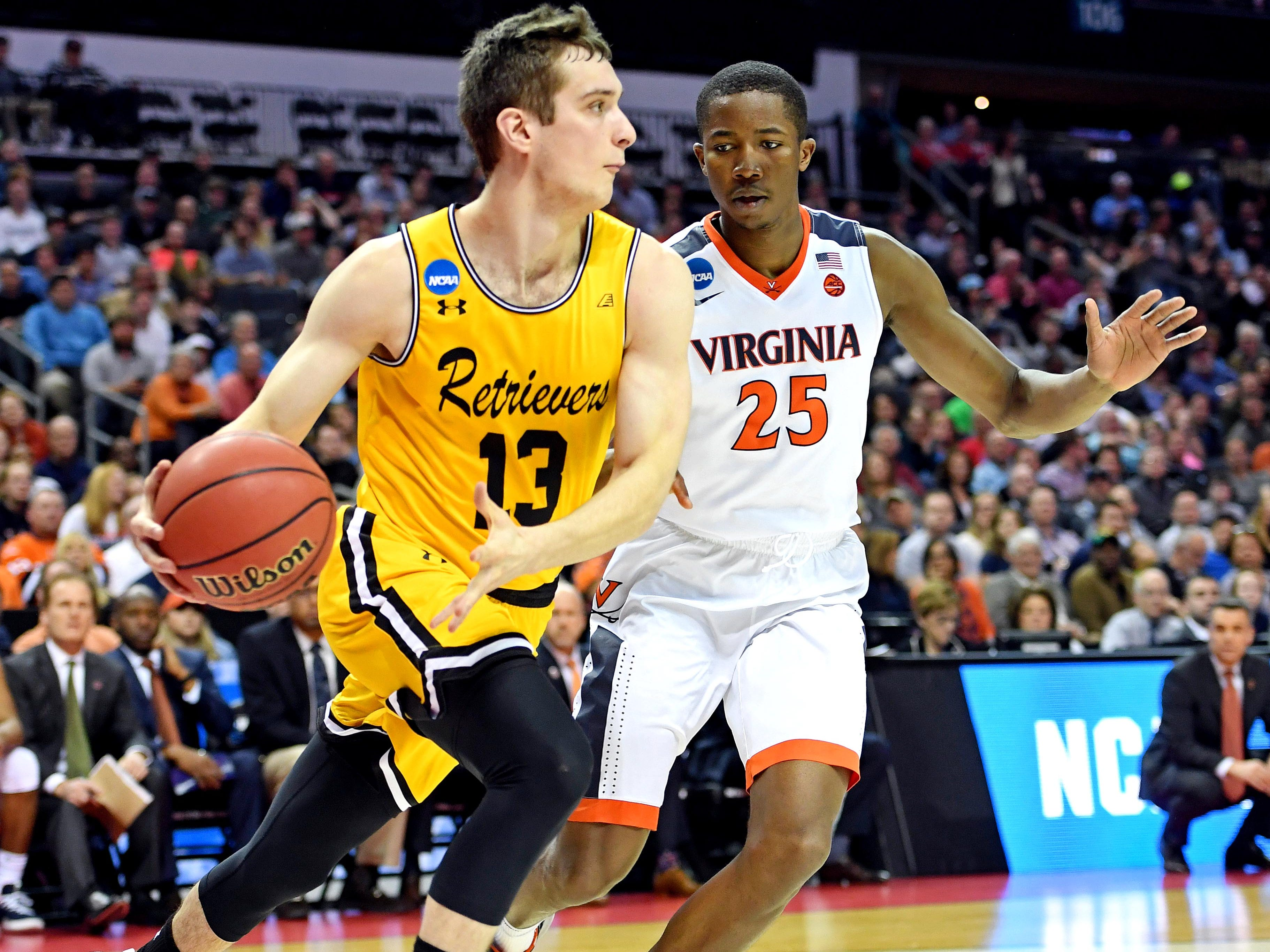 Mar 16, 2018; Charlotte, NC, USA; UMBC Retrievers forward Joe Sherburne (13) drives to the basket against Virginia Cavaliers forward Mamadi Diakite (25) during the first half in the first round of the 2018 NCAA Tournament at Spectrum Center. Mandatory Credit: Bob Donnan-USA TODAY Sports