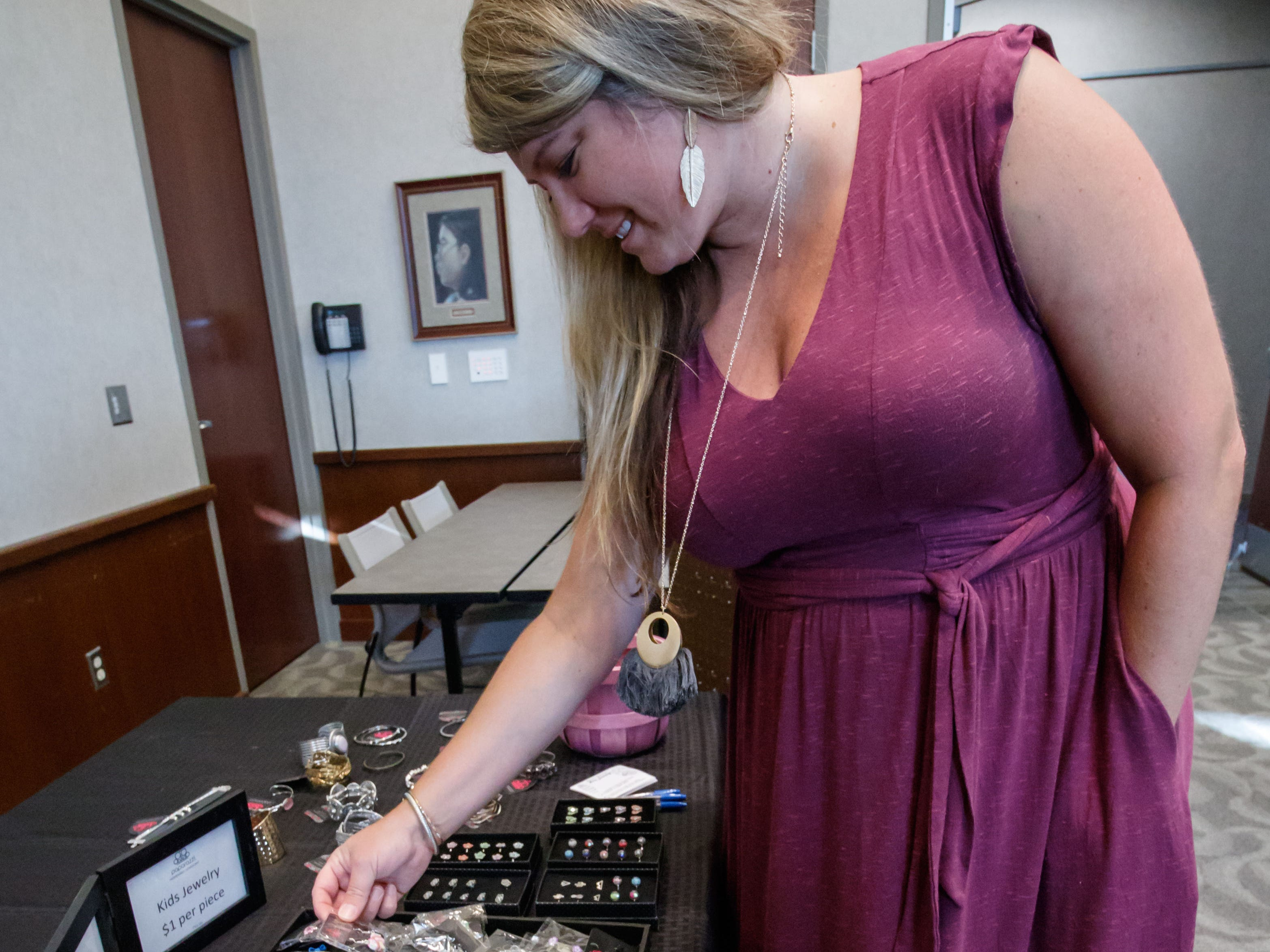 Jennifer Bjorson of Whitefish Bay shops for jewelry during the 2018 Holiday Bazaar at the Menomonee Falls Library on Saturday, Nov. 3. The annual event is a fundraising endeavor for the Friends of the Library, with a percentage of all sales supporting the group.
