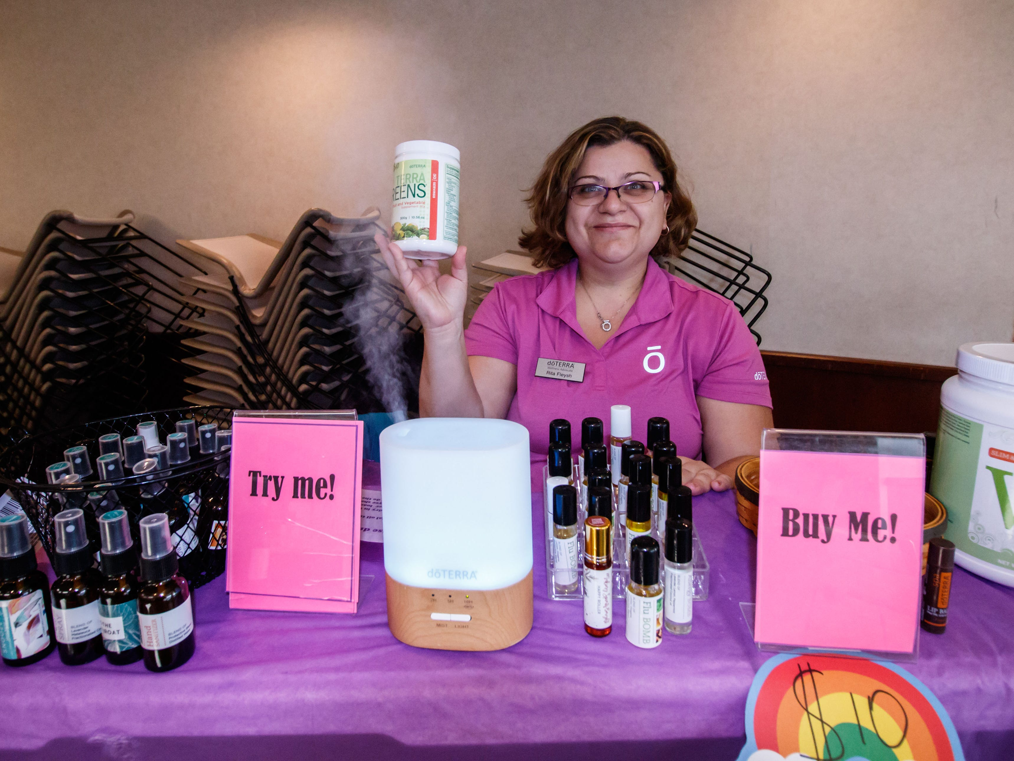 Rita Fleysh of doTerra GPTG Essential Oils in Menomonee Falls offers a variety of products during the 2018 Holiday Bazaar at the Menomonee Falls Library on Saturday, Nov. 3.