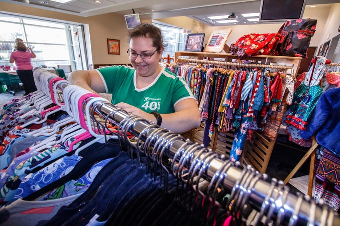 Kelly Schuelke of Cudahy shops for clothing during the 2018 Holiday Bazaar at the Menomonee Falls Library on Saturday, Nov. 3. The annual event is a fundraising endeavor for the Friends of the Library, with a percentage of all sales supporting the group.