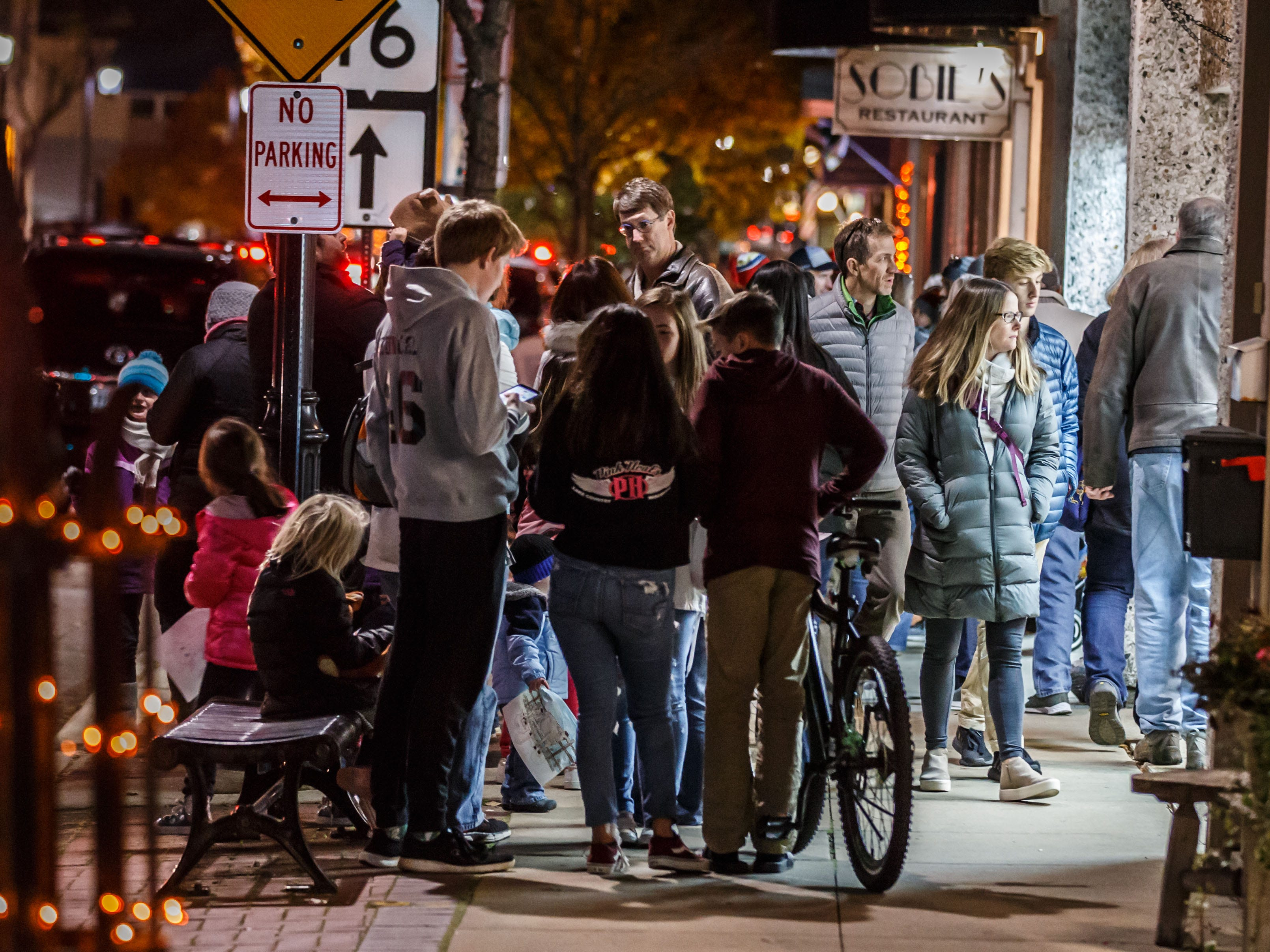 Downtown Oconomowoc bustles with activity during Fall Gallery Night on Friday, Nov. 2, 2018. The annual event, hosted by the Downtown Oconomowoc Business Association, features an evening of art, live music, shopping and more.