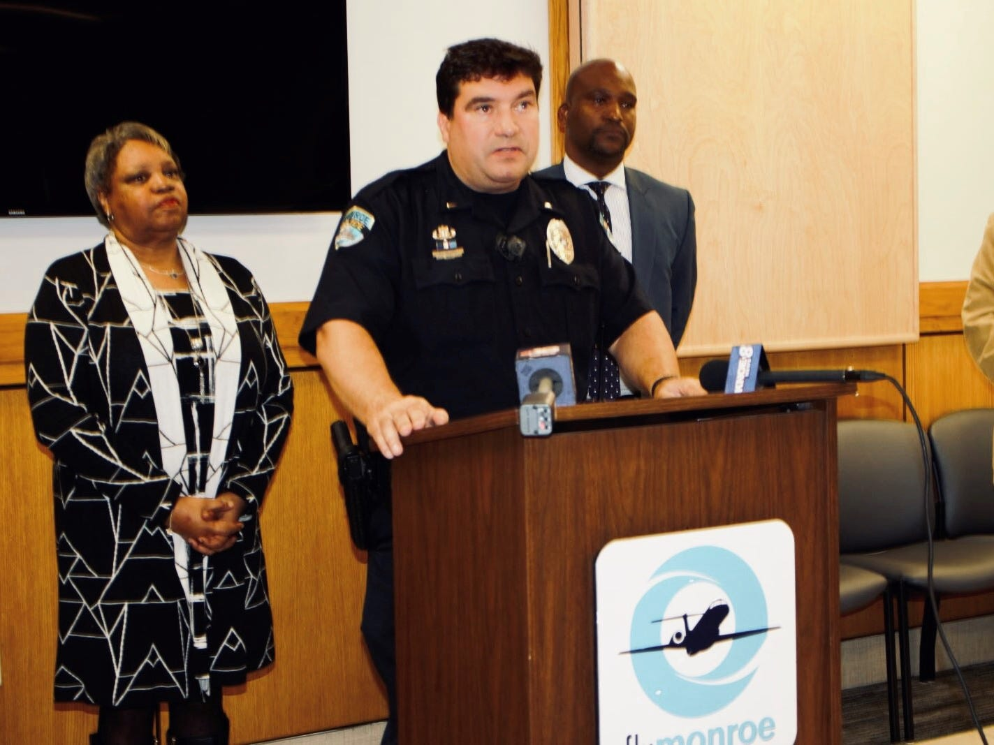 Monroe officials discuss the interruption to service at the airport Monday morning.
