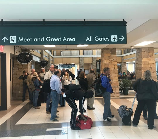 When operations resumed at the airport, a long security line awaited passengers.
