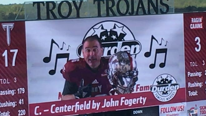 Troy baseball coach Mark Smartt expresses his desire to try football during a promotion at last weekend's game between the Trojans and Louisiana-Lafayette.