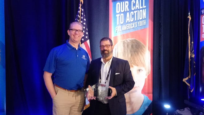 Jason Newman, Boys & Girls Clubs of Muncie CEO, and James Mitchell, board president, accepted two awards at this year's Boys & Girls Clubs of America Regional Leadership Conference on Oct. 11.