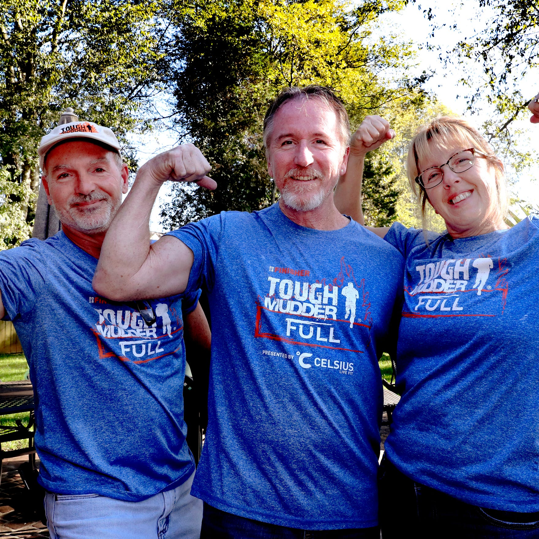 Scott Degenhardt, left, Bruce Ippel, center, and Tina Ippel, right all competed together in a tough mudder event despite Bruce Ippel being diagnosed with MS, on Wednesday, Oct. 24, 2018.