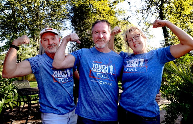 Scott Degenhardt, left, Bruce Ippel and Tina Ippel competed together in a Tough Mudder event. The competition was a milestone for Bruce Ippel, who has MS.
