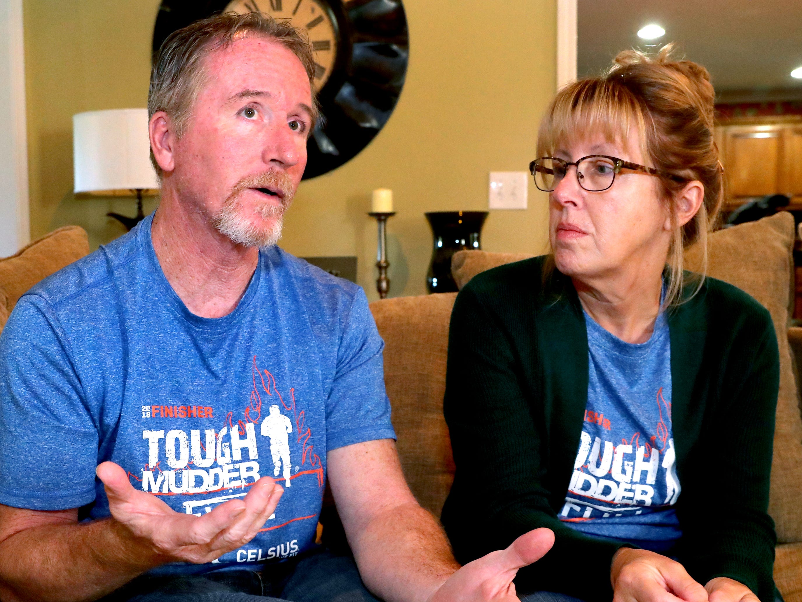 Bruce Ippel, left, talks about his life after being diagnosed with MS and training and competing in tough mudders events, as his wife Tina Ippel, right listens to his story, on Wednesday, Oct. 24, 2018.