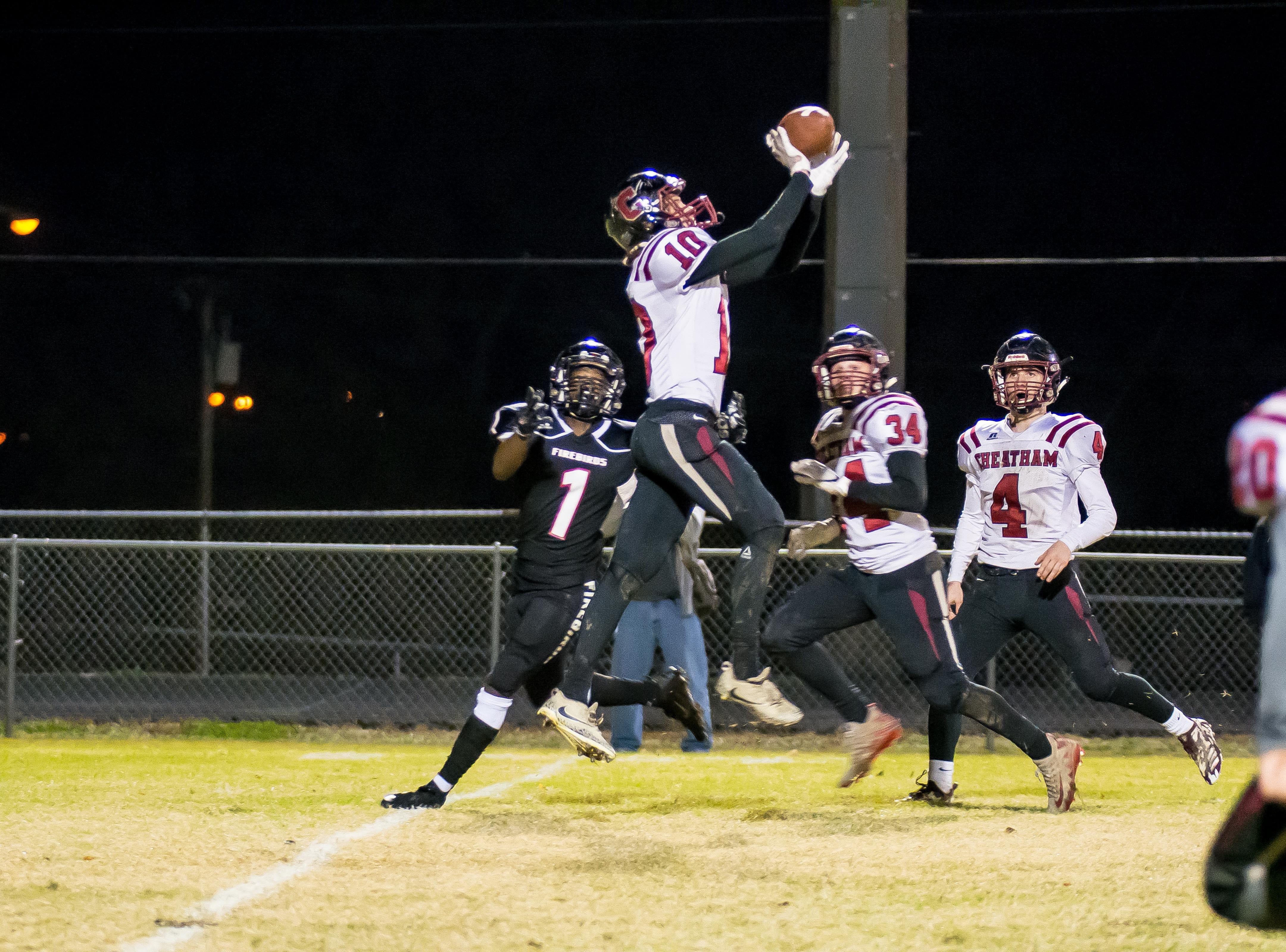 Cheatham County's Joe Mosley intercepts a pass from Xavier Shepherd.