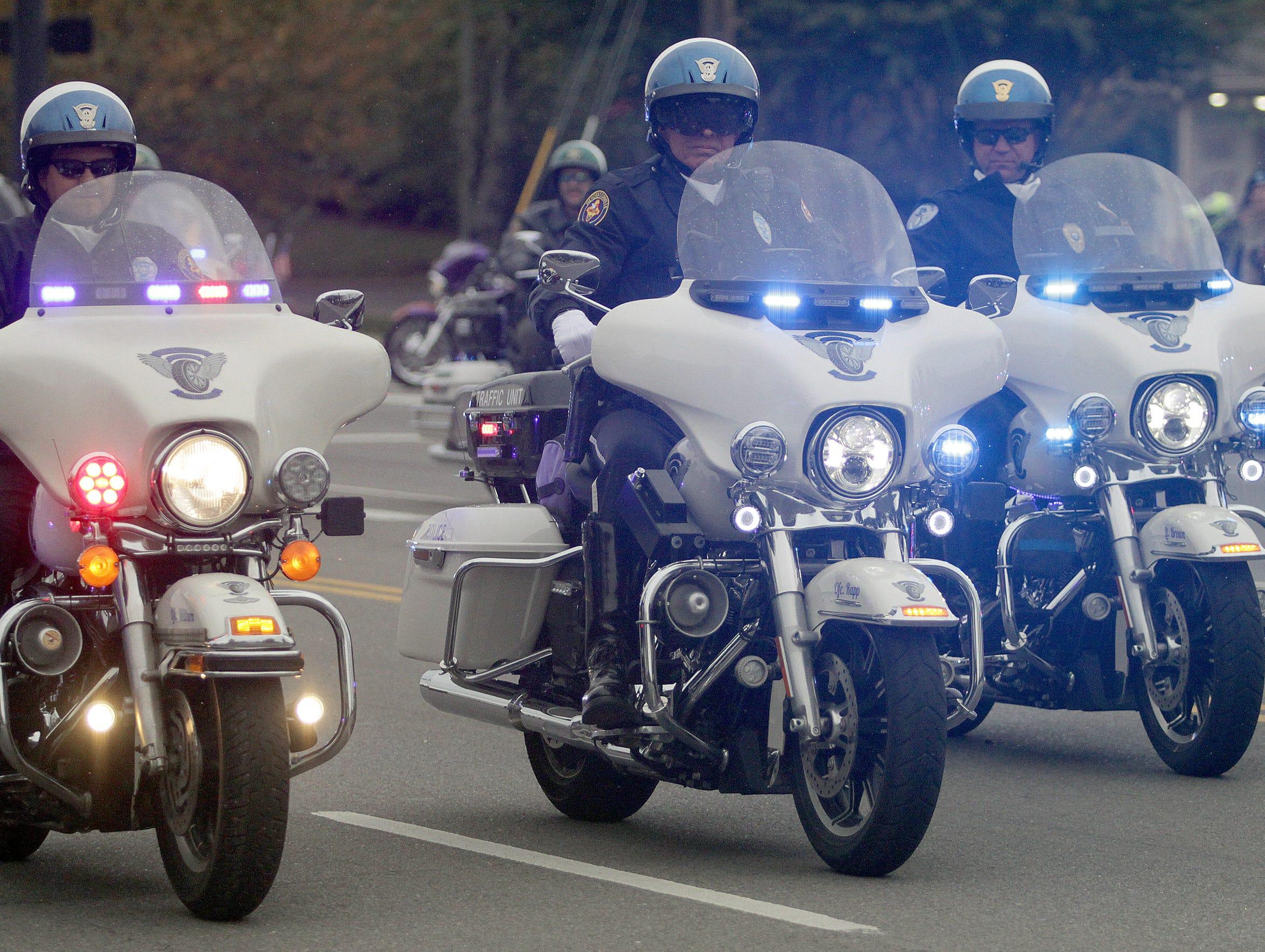 The Hendersonville Police start the Veterans Day Parade on Sunday, November 4, 2018.