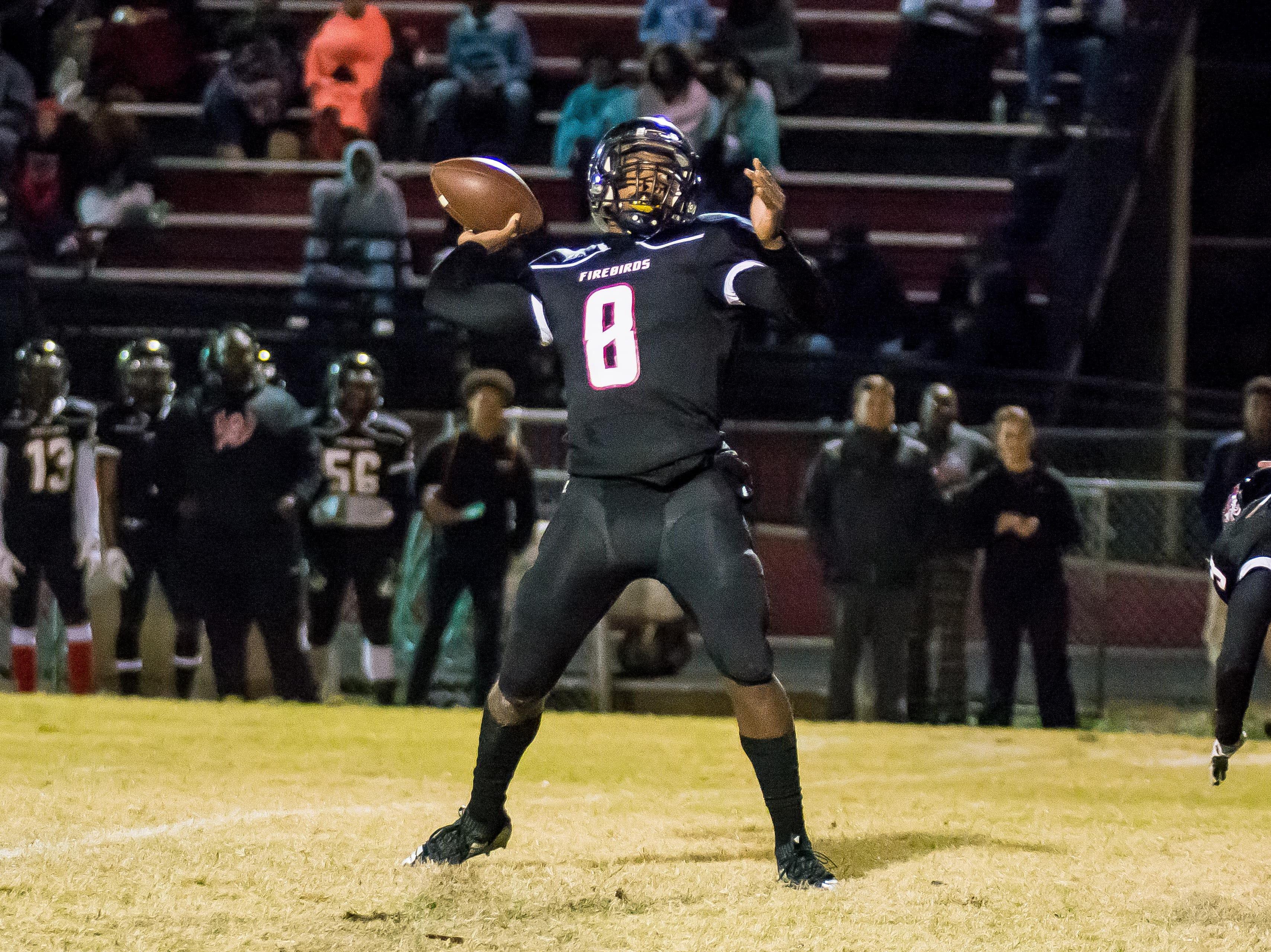 Pearl-Cohn quarterback Xavier Shepherd throws a touchdown pass against Cheatham County.