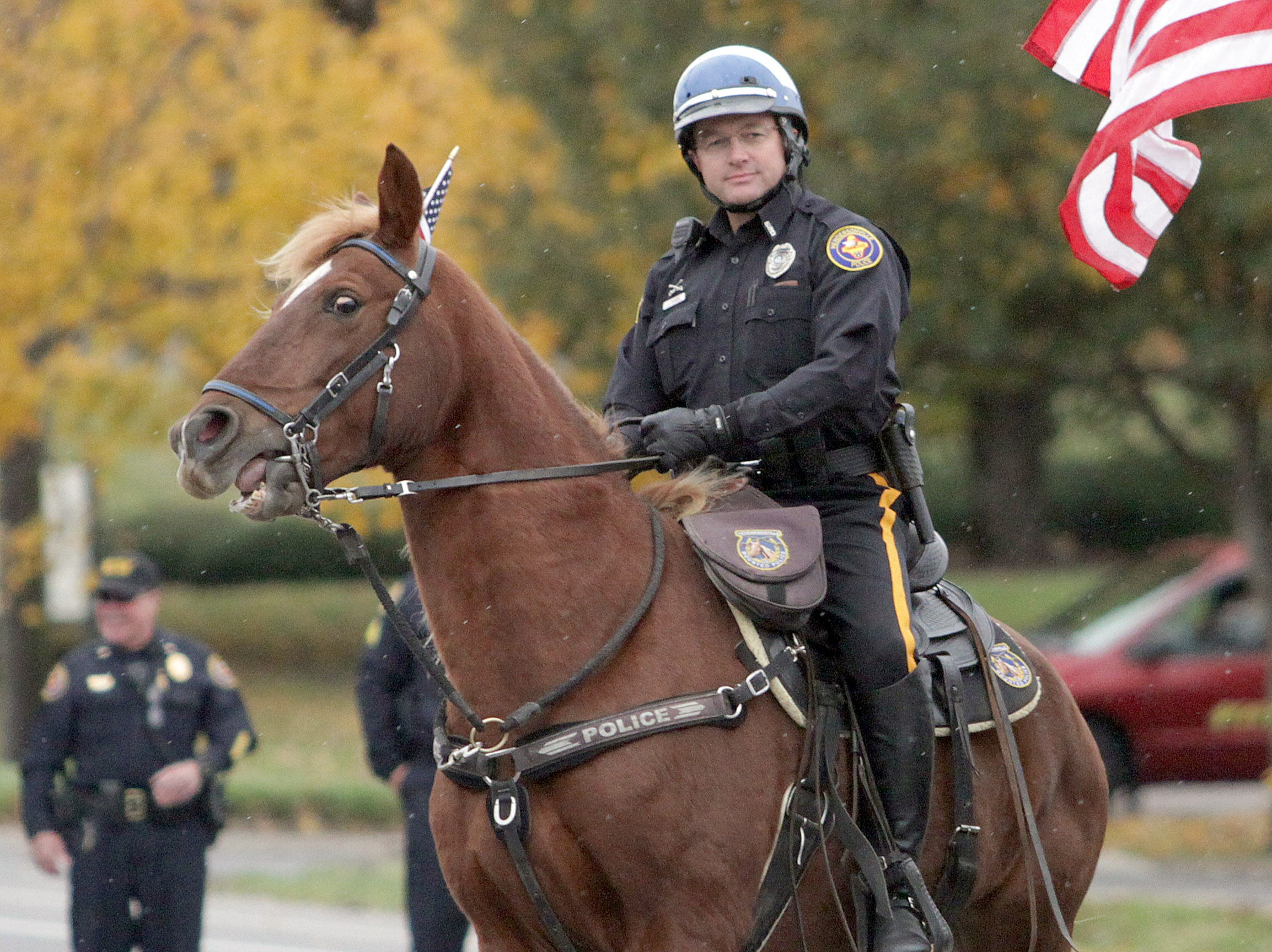A Mounted Officer rides in the Veterans Day Parade in Hendersonville, TN on Sunday, November 3, 2018.
