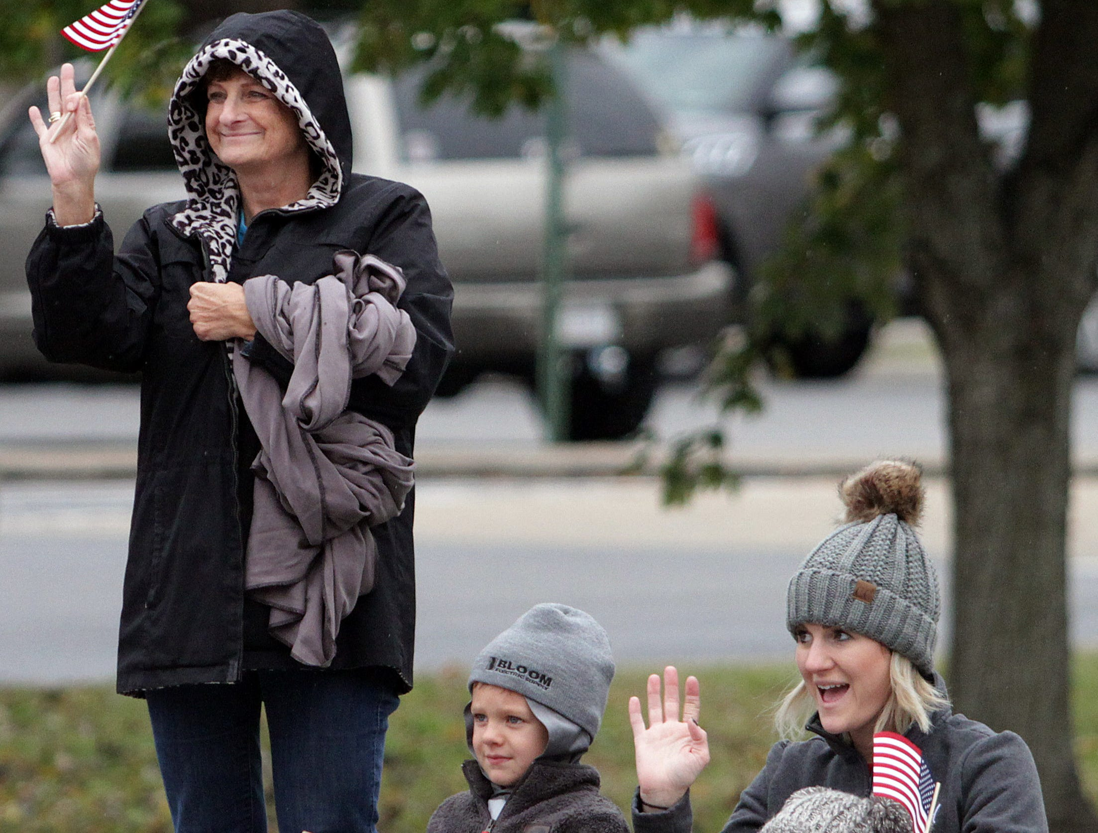 L-R Lori Hagson, Elliott Tripp (5) with mom Katie and sister Hadley (3 months) wave to the Veterans in the parade in Hendersonville, TN on Sunday, November 4, 2018.