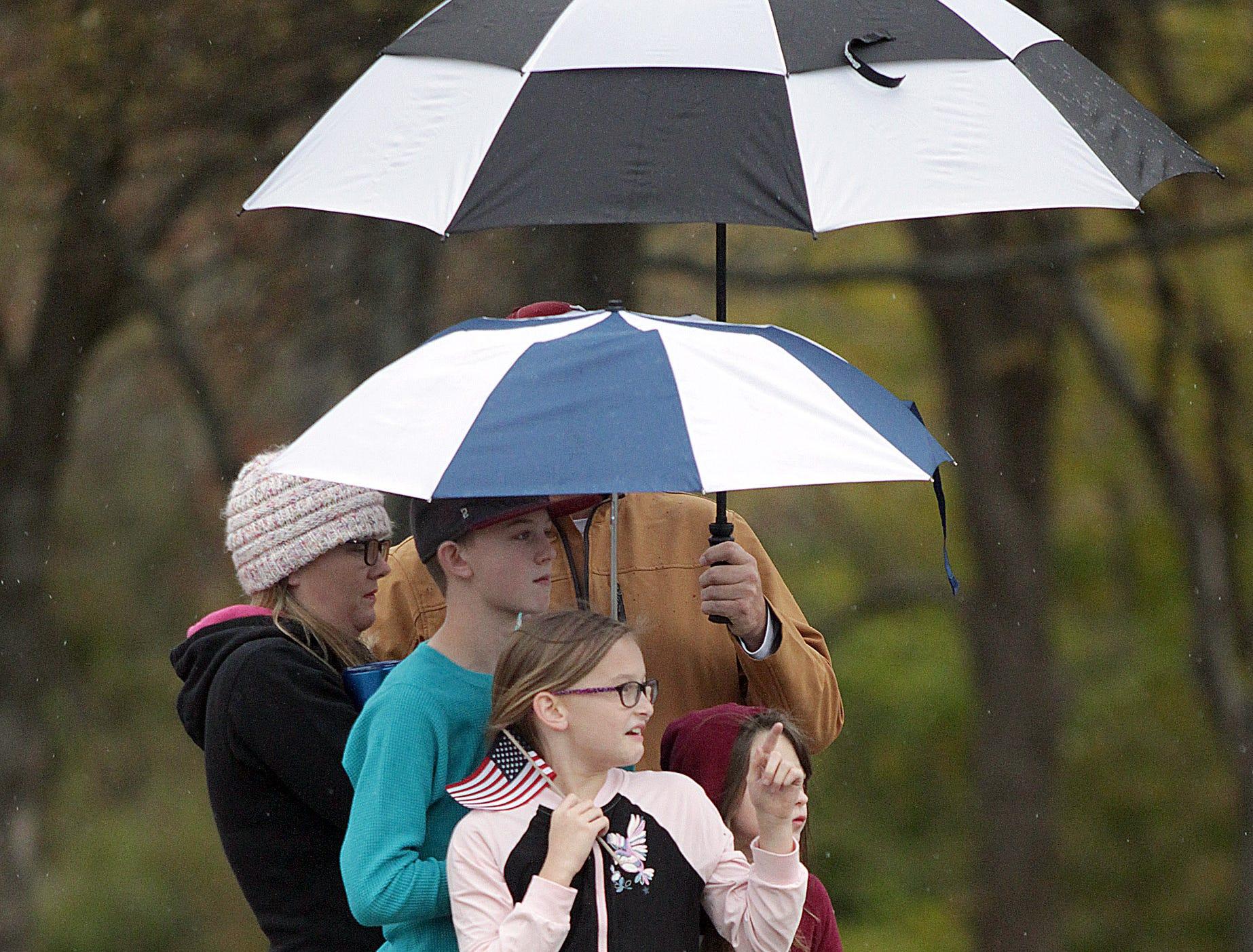 Folks brave the rain to watch the Veterans Day Parade in Henderonville, TN on Sunday, November 4, 2018.
