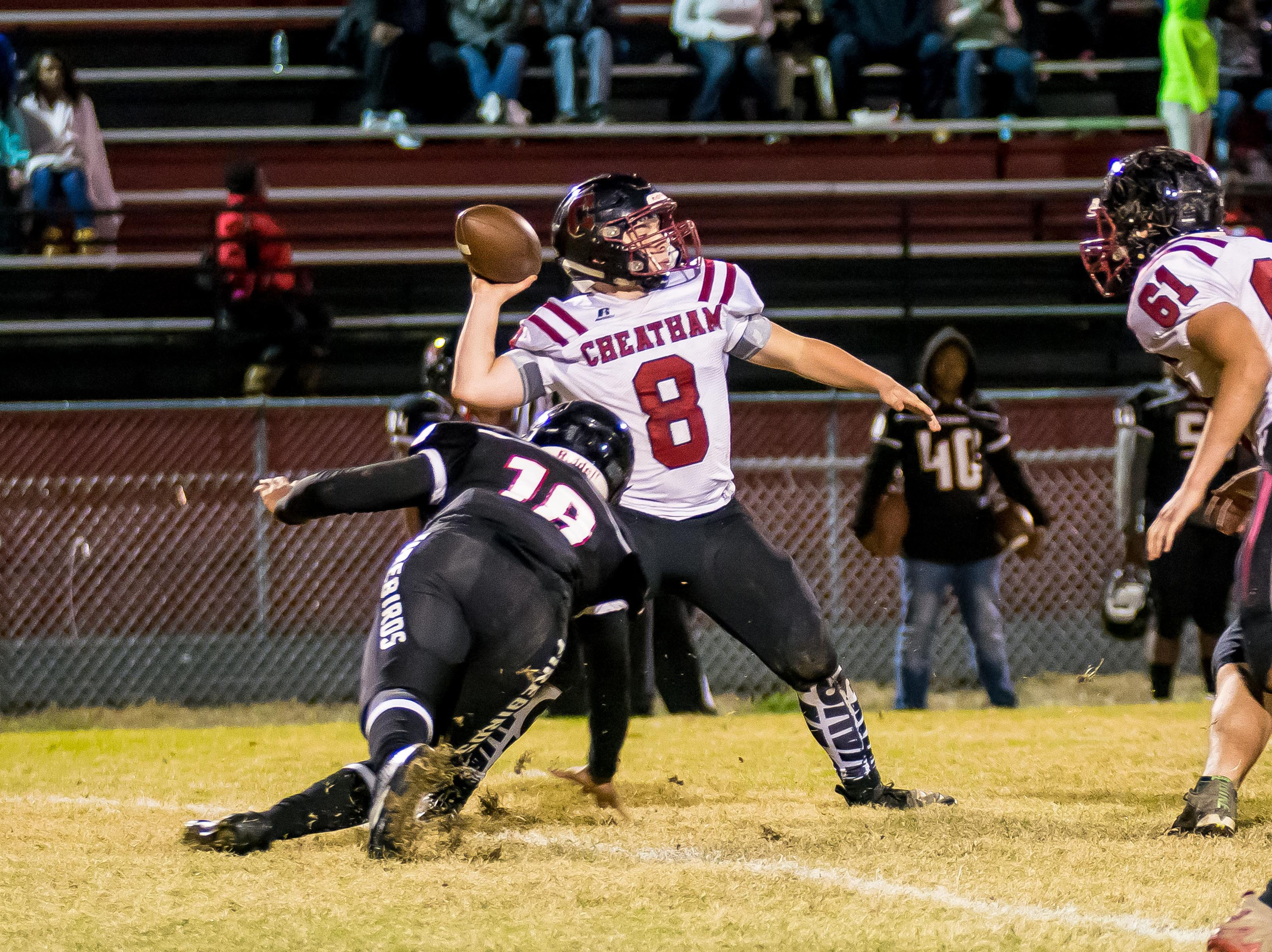 Cheatham County's Bryson Entrikin, who was in at quarterback for most of the game, drops back to pass.