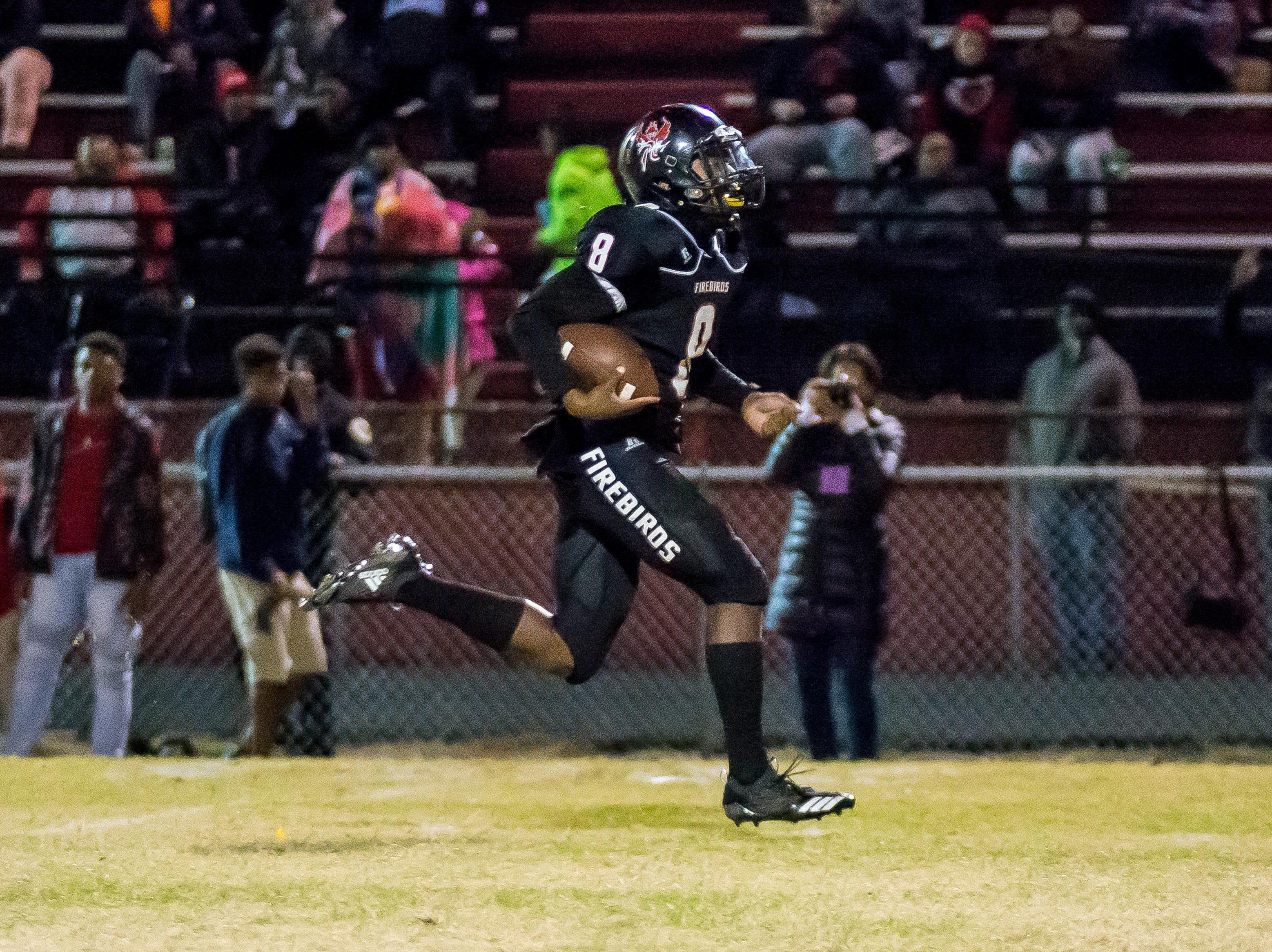 Pearl-Cohn quarterback Xavier Shepherd breaks through for a 55-yard touchdown run.