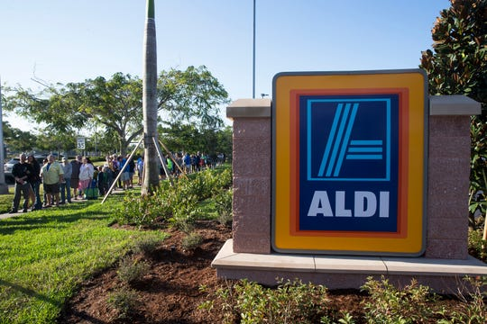 People wait in line for the grand opening of the first ALDI store in Naples, Fla., earlier this month.