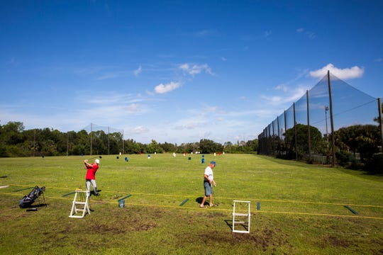 Keith Copenhaver, left, and Randy Neustifter hit balls together at Golf Coast Driving Range in Estero on Monday, Nov. 5, 2018.