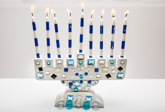 Mimi Goldberg, age 11, of Naples, was inspired to create this Hanukkah menorah using gemstones, jewels, beads and sequins she had been saving.