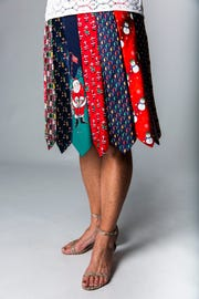 Sisters Denise Kluthe, of Naples, and Karen Elliott, of Silver Spring, Maryland, brought an impressive attention to detail to this skirt using a collection of old holiday-themed neckties.