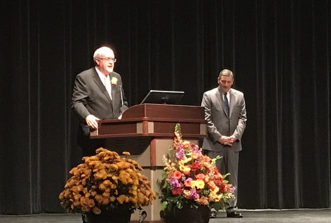 Chris Meyer, a local lawyer, gives a speech at Ohio State University - Newark Friday night after he received Licking Memorial Health System's Lifetime Achievement Award.