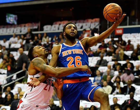 Washington, DC, USA; New York Knicks center Mitchell Robinson (26) is fouled by Washington Wizards center Dwight Howard (21) during the first half at Capital One.