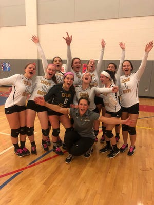 Cedar Grove coach Alicia Angione (kneeling) and the Panthers celebrate a victory at Secaucus in the first round of the Group 1 tournament.