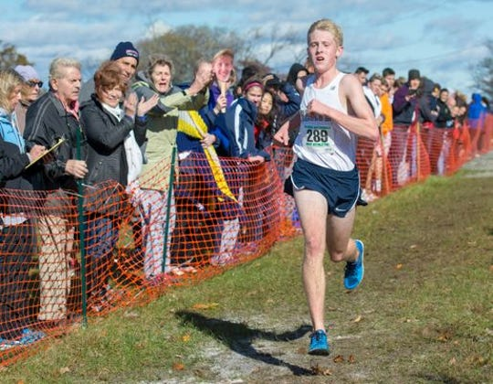 Bobby Oehrlein of Indian Hills is cheered on as he approaches the finish line to place first in the Group 2 Boys 5k Run during the NJSIAA XC Sectional on Nov. 3.