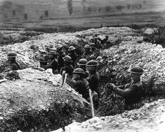 U.S. Army troops stand in the trenches in France during World War I. Almost 50 Baxter County residents served in the armed forces during 'The Great War,' which ended 100 years ago Sunday.