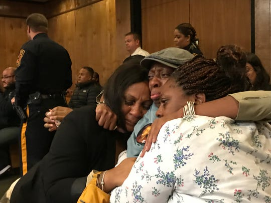 Naomi Fields, ( center), burst into tears after the verdict was read.