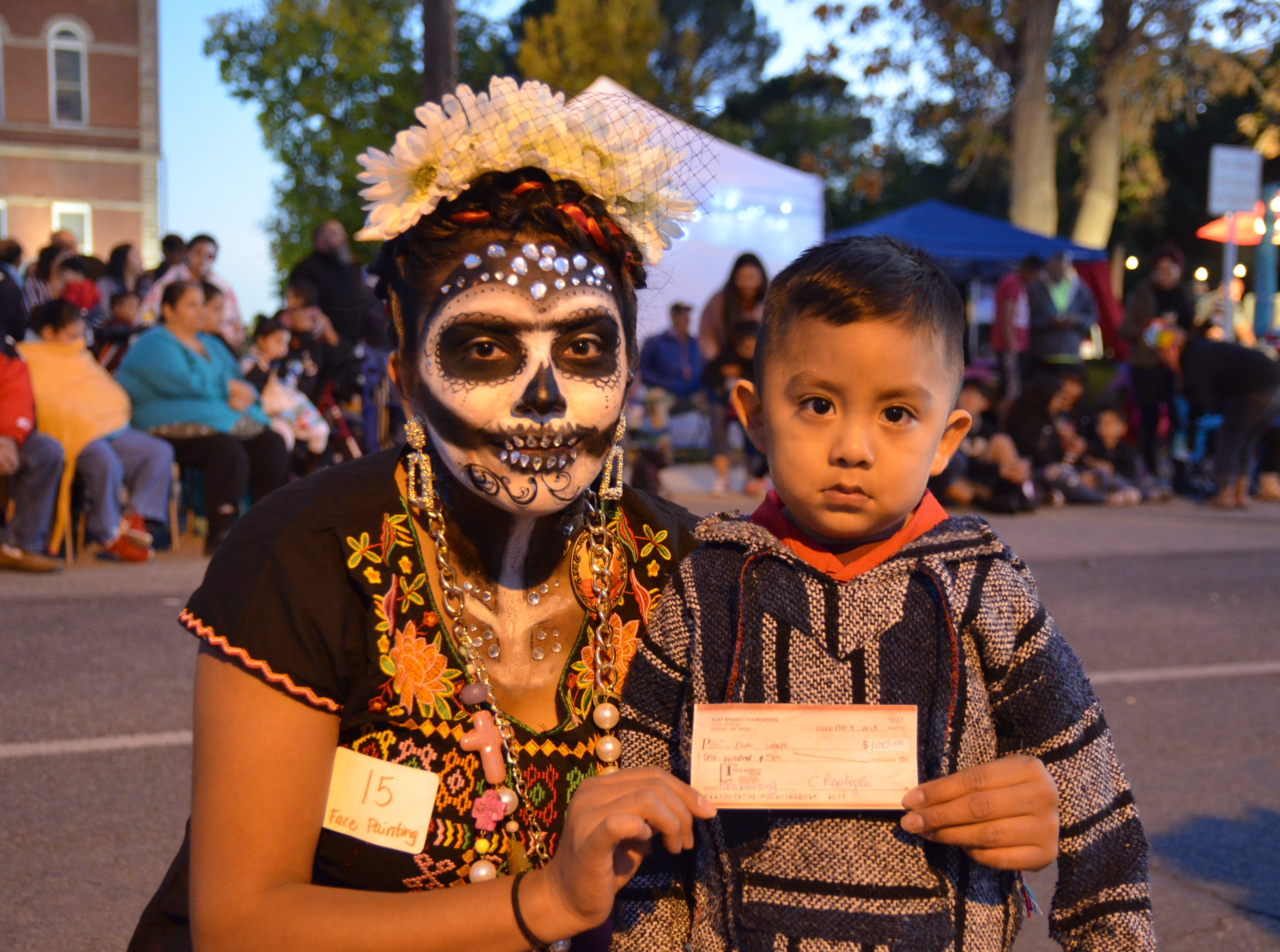 First place winner of face painting contest, Elva Lobato and her son.