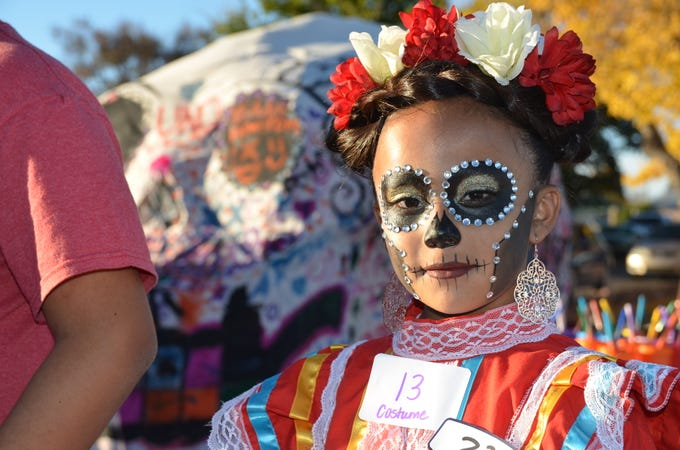 Gema Sanchez, 8, patiently waiting to be judged for the face painting contest during Deming's first annual Dia de los Muertos event celebration. She also participated in the costume contest.