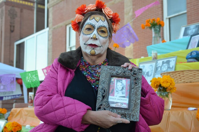 Diane Jackson holds a portrait of her daughter, Erica Nicole Jackson to whom she lost 16 years ago. Erica's photo was one of more than 100 portraits displayed out on the steps of the Luna County Courthouse in honor of Dia de los Muertos.