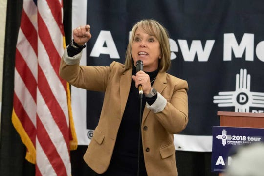 Michelle Lujan Grisham, seeing during a November campaign rally in Las Cruces, ran for governor on a promise to scrap PARCC exams and A-F grades for schools.