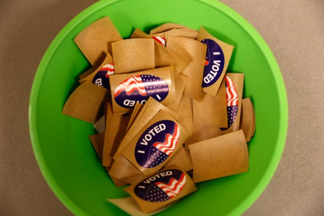 Stickers are handed out to voters, Tuesday, Nov. 8, 2016 at the Farmington Civic Center.