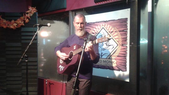 Drew White sings an original tune at Third Monk Brewery in South Lyon.