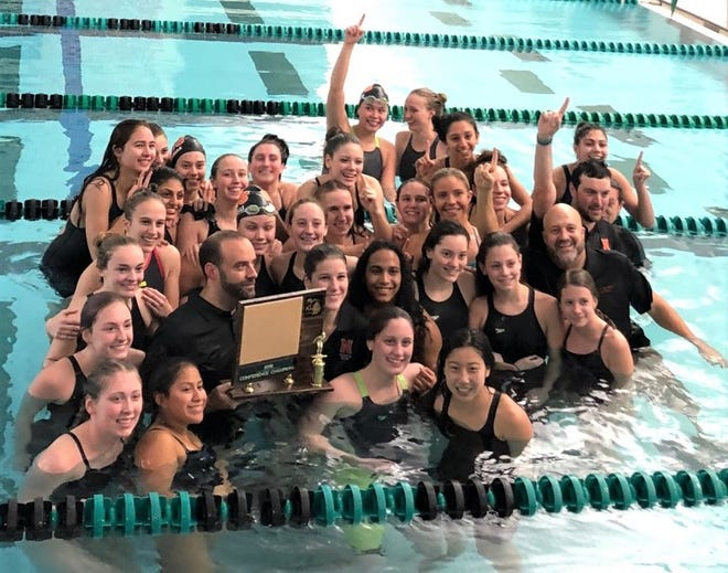 Northville celebrates its Kensington Lakes Activities Association girls swimming and diving title.
