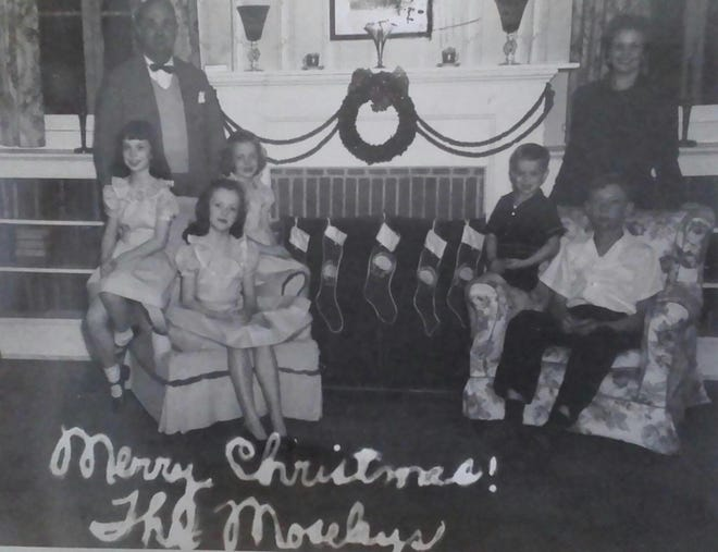The  H.V. Moseley family at Christmas, 1947. Seated from left: Margaret, Mary, Little Jo, Matt and Vincent. Behind them are H.V. Moseley and Josephine Dubuisson Moseley.