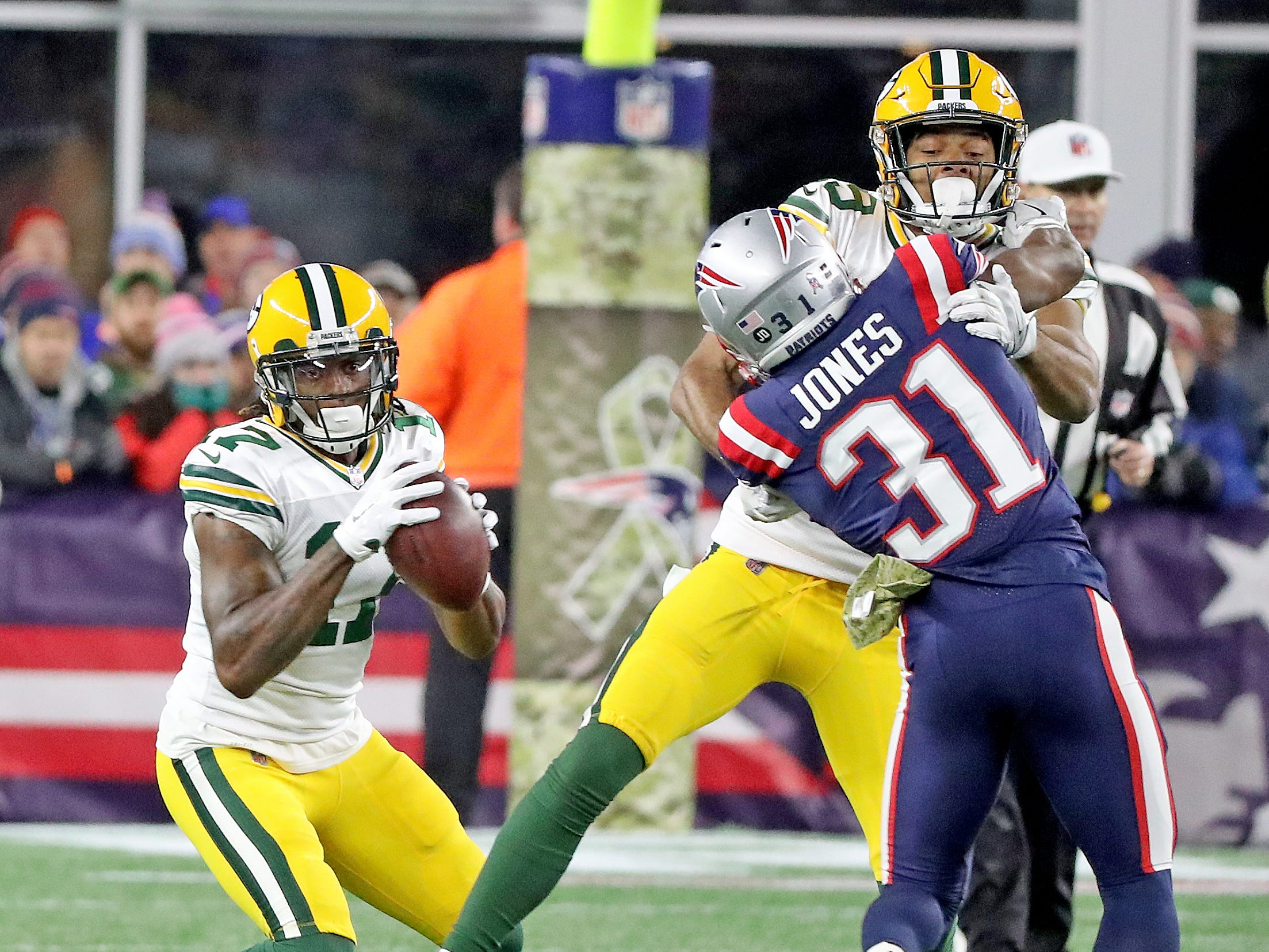 Green Bay Packers wide receiver Davante Adams (17) makes a catch as wide receiver Equanimeous St. Brown (19) blocks against the New England Patriots Sunday, November 4, 2018 at Gillette Stadium in Foxborough, Mass.