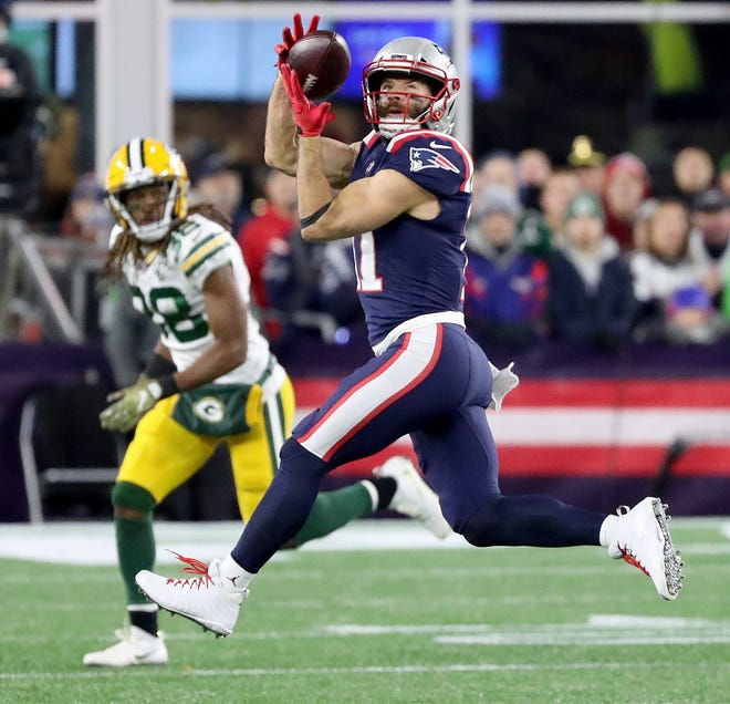 Green Bay Packers cornerback Tramon Williams (38) watches as wide receiver Julian Edelman (11) makes a catch against the New England Patriots Sunday, November 4, 2018 at Gillette Stadium in Foxboro, Mass.