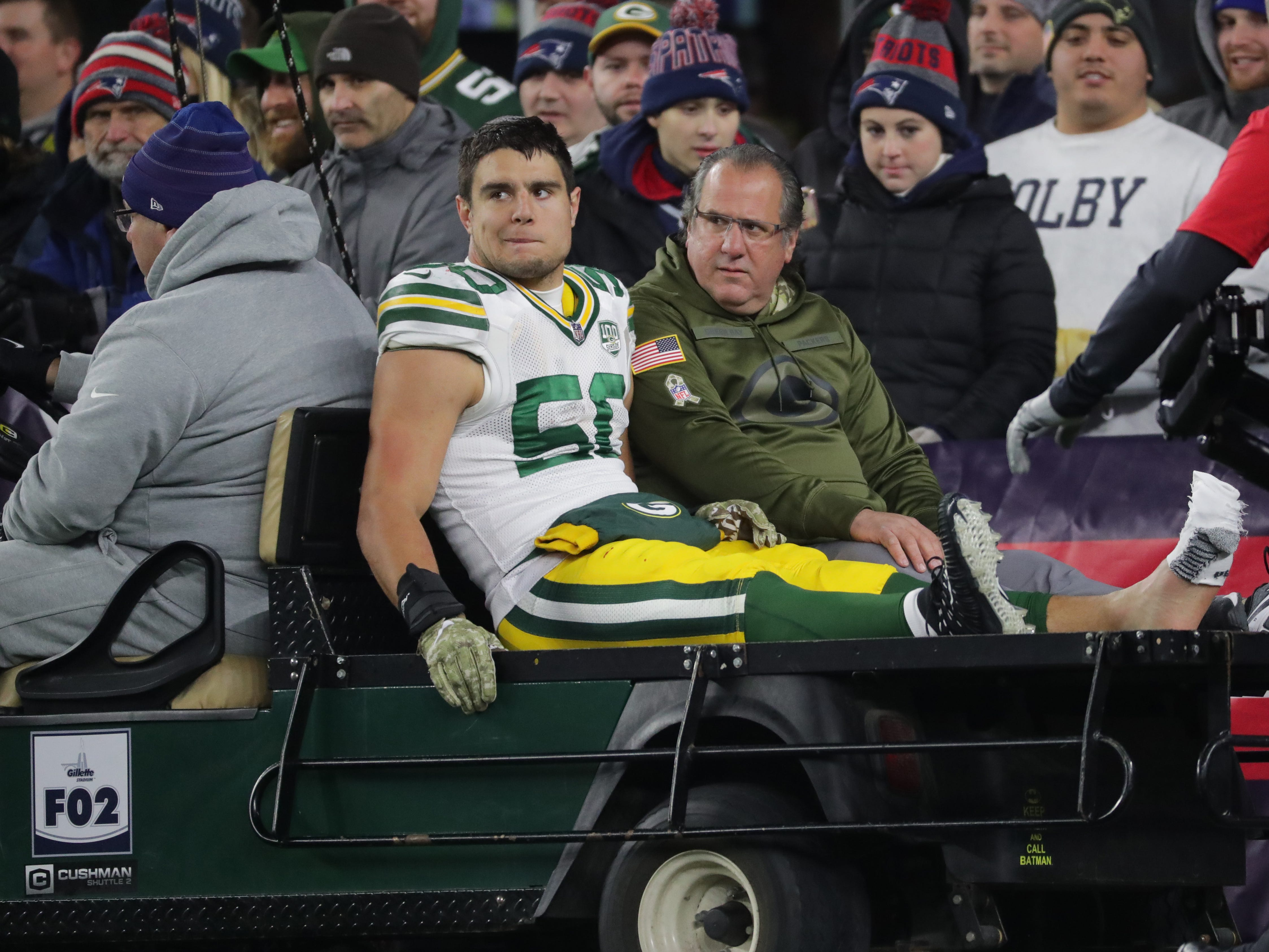 Green Bay Packers inside linebacker Blake Martinez (50) is carted from the field after being injured during the third  quarter of their game Sunday, November 4, 2018 at Gillette Stadium in Foxborough, Mass. The New England Patriots beat the Green Bay Packers 31-17.