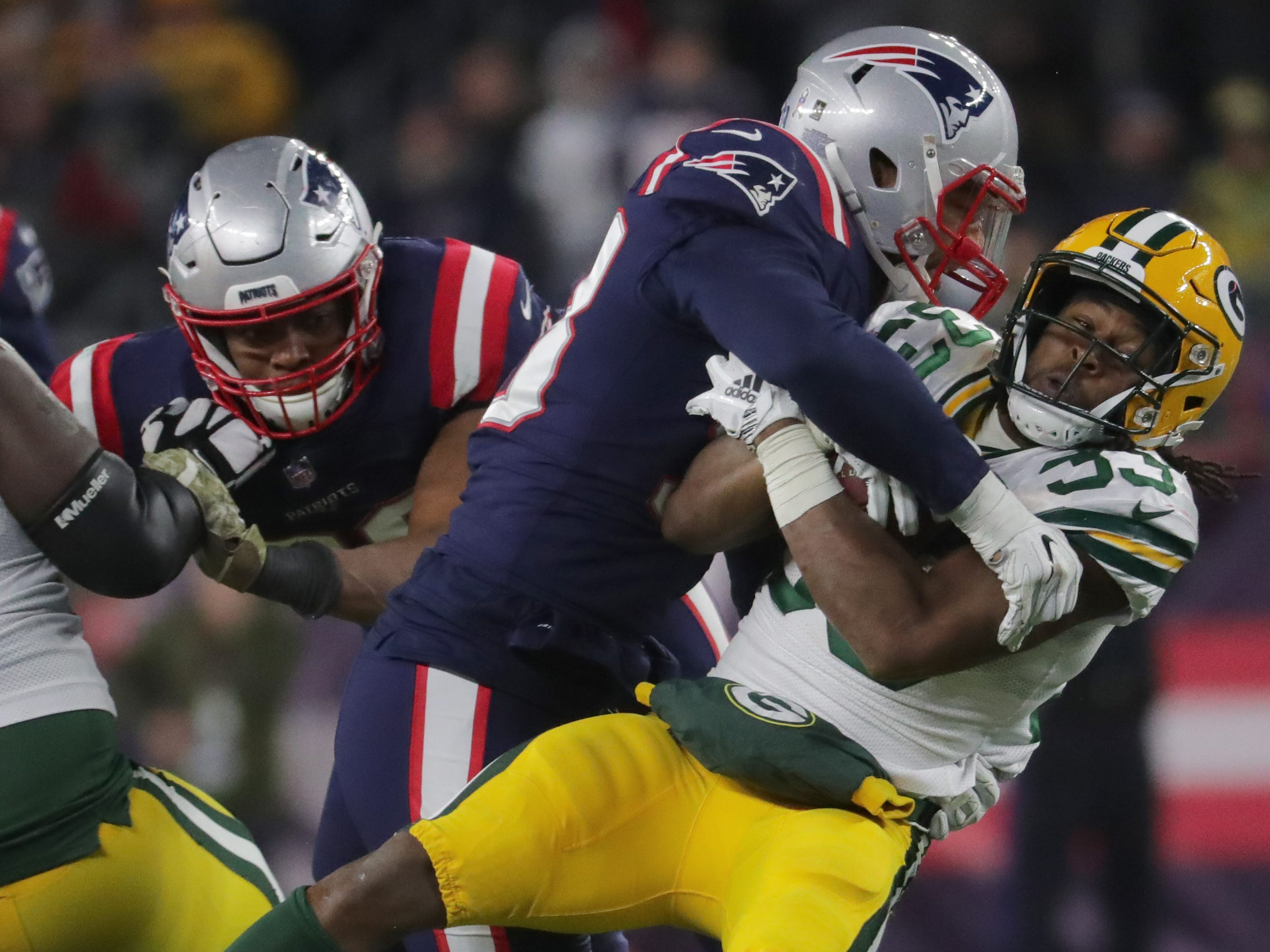 New England Patriots middle linebacker Kyle Van Noy (53) stuffs Green Bay Packers running back Aaron Jones (33) at the line during the fourth quarter of their game Sunday, November 4, 2018 at Gillette Stadium in Foxborough, Mass. The New England Patriots beat the Green Bay Packers 31-17.