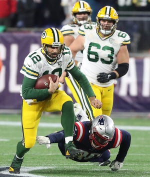 Green Bay Packers quarterback Aaron Rodgers (12) scrambles for a first down against the New England Patriots Sunday, November 4, 2018 at Gillette Stadium in Foxborough, Mass.