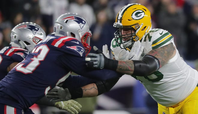 Green Bay Packers offensive tackle Jason Spriggs (78) blocks New England Patriots middle linebacker Kyle Van Noy (53) during the second quarter of their game Sunday, November 4, 2018 at Gillette Stadium in Foxborough, Mass.