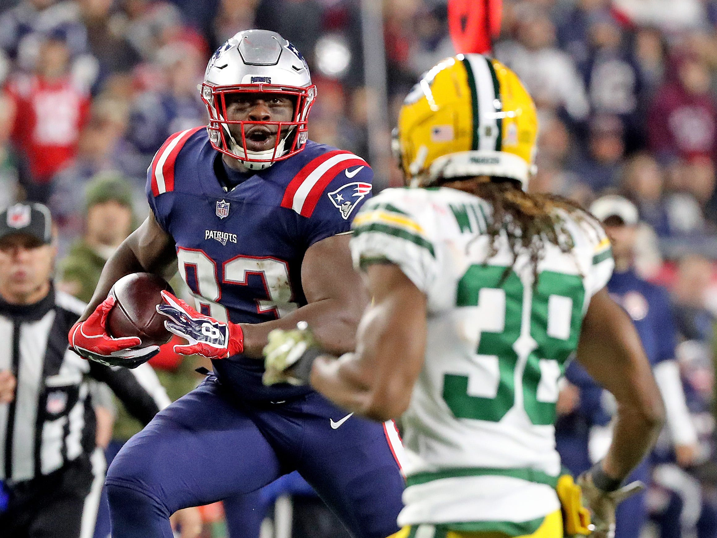 Green Bay Packers cornerback Tramon Williams (38) closes in on tight end Dwayne Allen (83) against the New England Patriots Sunday, November 4, 2018 at Gillette Stadium in Foxborough, Mass.