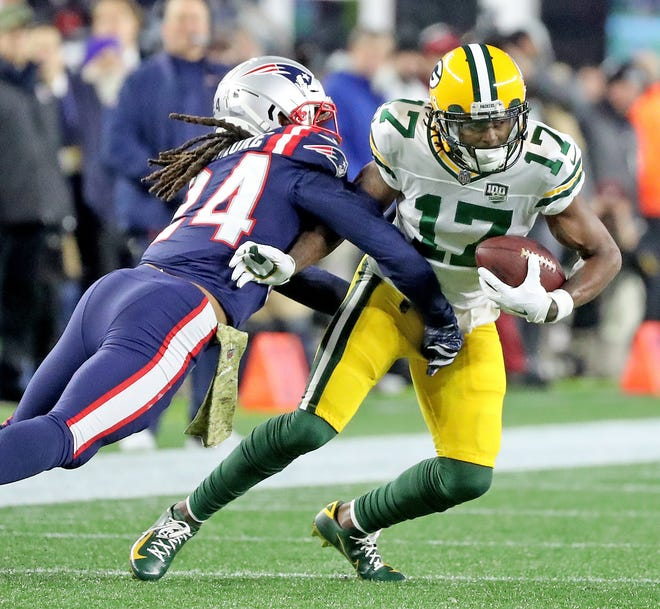 Green Bay Packers wide receiver Davante Adams (17) tries to move past cornerback Stephon Gilmore (24) after a reception against the New England Patriots Sunday, November 4, 2018 at Gillette Stadium in Foxboro, Mass.